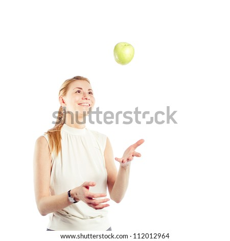 Smiling business woman with green apple - stock photo