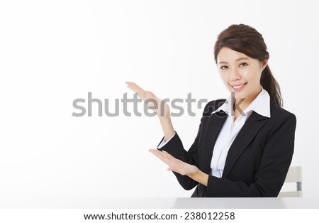 smiling business woman with  showing gesture - stock photo