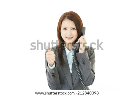 Smiling business woman with thumbs up - stock photo
