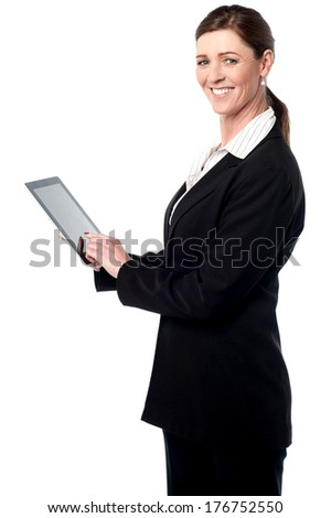 Smiling business woman working in tablet pc device