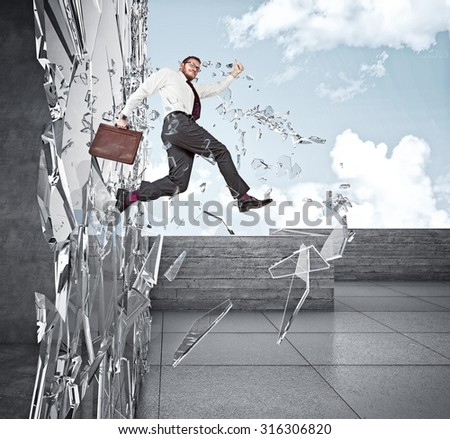 smiling businessman broke glass with jump - stock photo