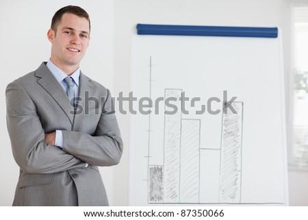 Smiling businessman confident about his diagram - stock photo