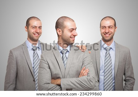Smiling businessman congratulating with himself - stock photo