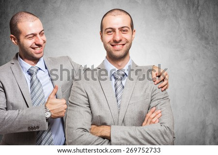 Smiling businessman congratulating with himself