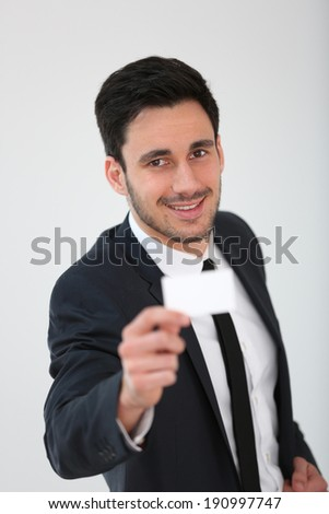 Smiling businessman giving businesscard to client