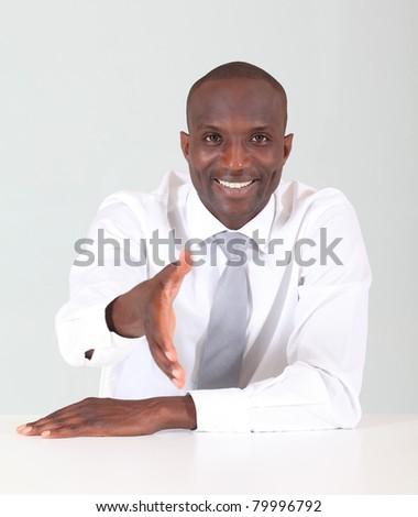 Smiling businessman, giving hand for handshake - stock photo