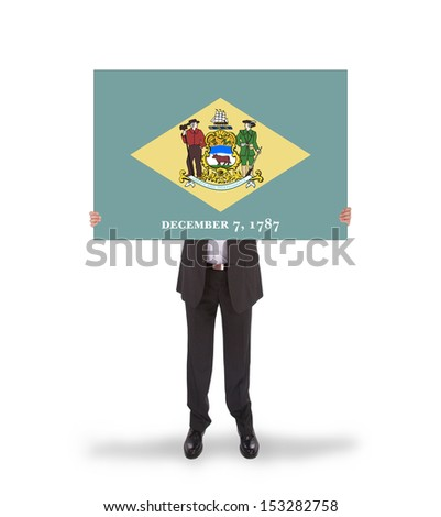 Smiling businessman holding a big card, flag of Delaware, isolated on white - stock photo