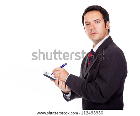 Smiling businessman holding a clipboard isolated on white background - stock photo