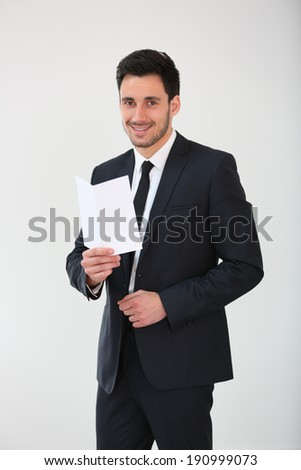Smiling businessman holding blank flyer
