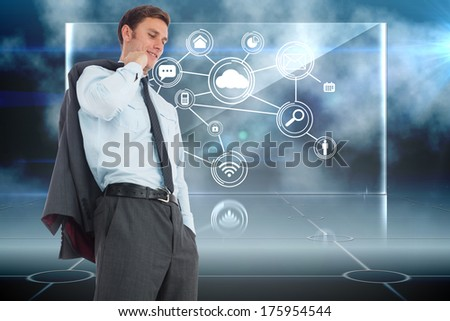 Smiling businessman holding his jacket against futuristic technology interface