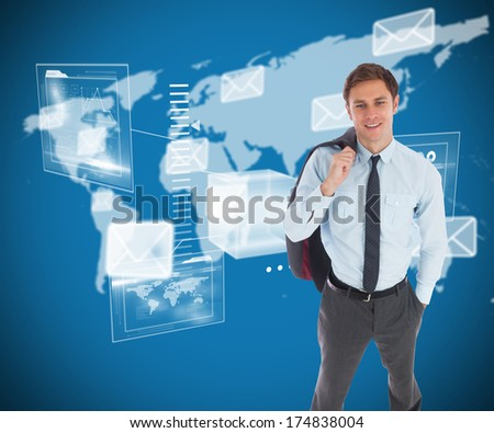 Smiling businessman holding his jacket against world map with envelopes