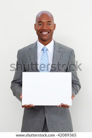 Smiling businessman holding white card isolated on white background - stock photo