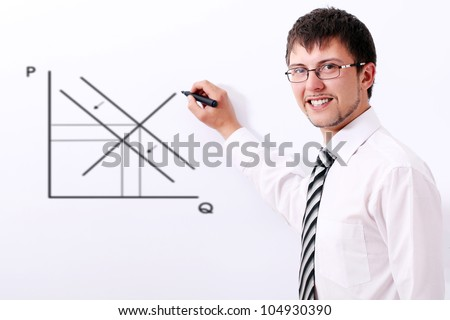 Smiling businessman in glasses drawing the supply and demand graph - stock photo