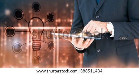 Smiling businessman in glasses with arms out against futuristic shiny black background - stock photo