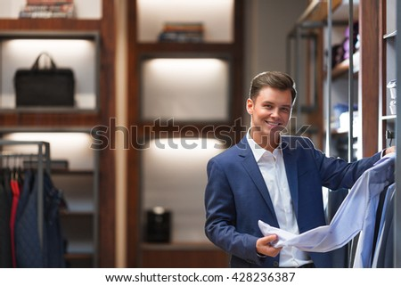 Smiling businessman in shop