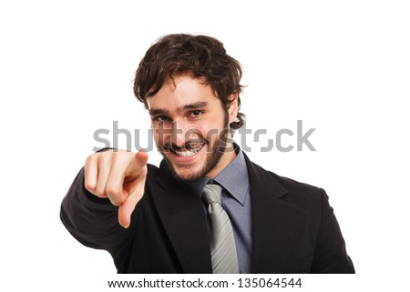 Smiling businessman pointing his finger - stock photo