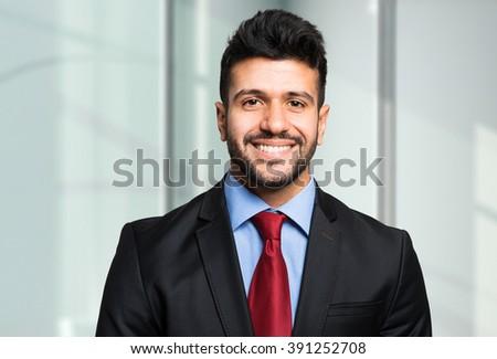 Smiling businessman portrait - stock photo