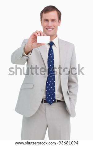 Smiling businessman presenting his business card against a white background - stock photo