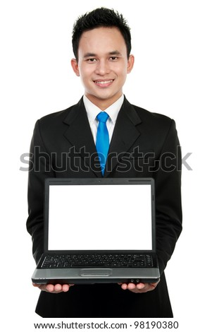 Smiling businessman showing a blank laptop against a white background