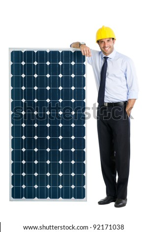 Smiling businessman showing a solar panel, symbol of green energy and good environmental business - stock photo