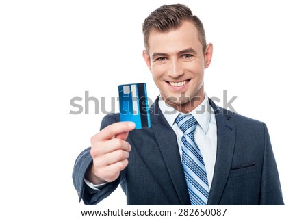 Smiling businessman showing his credit card