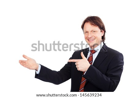 smiling businessman showing something in his hands - stock photo