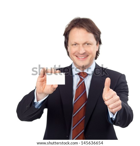 smiling businessman showing white card and thumb up sign - stock photo