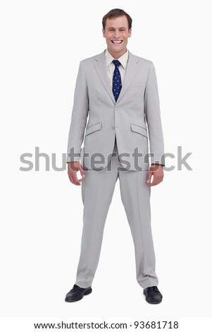 Smiling businessman standing against a white background