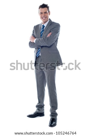 Smiling businessman standing with arms crossed against white background - stock photo