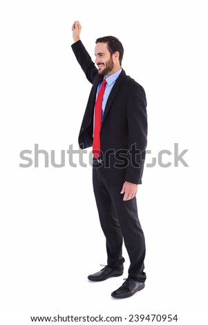 Smiling businessman standing with hand raised on white background