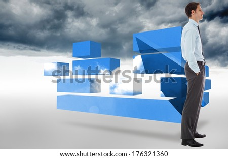 Smiling businessman standing with hands in pockets against cloudy sky background