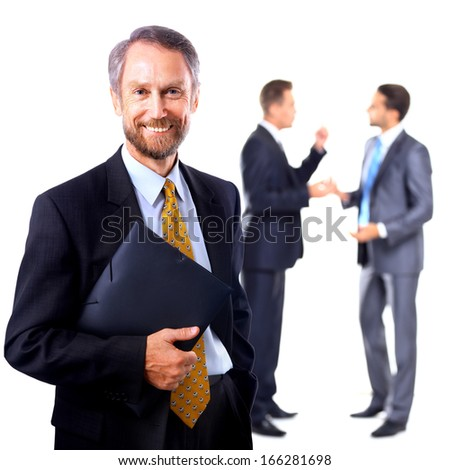 Smiling businessman standing with his colleagues. Isolated on white  - stock photo
