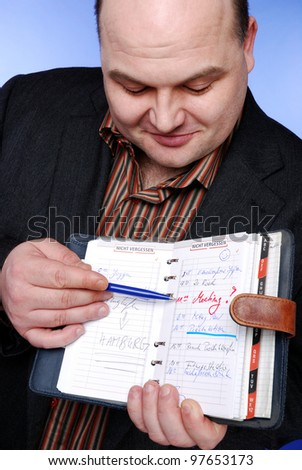 smiling businessman with daily planner