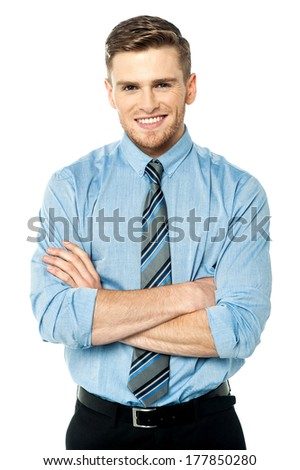 Smiling businessman with folded arms isolated on white background - stock photo