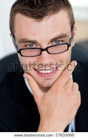 Smiling businessman with glasses in his office - stock photo