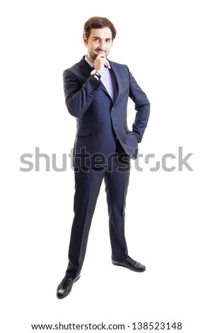Smiling businessman with hand on hip isolated on white - stock photo