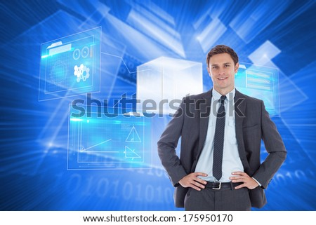 Smiling businessman with hands on hips against shiny technological background