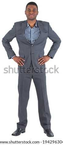 Smiling businessman with hands on hips on white background