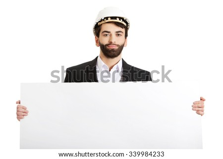 Smiling businessman with hard hat holding empty banner.