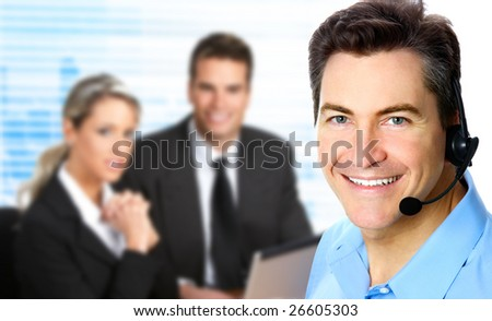 Smiling  businessman with headset in the office