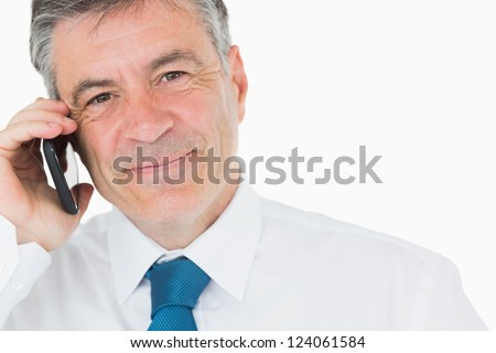 Smiling businessman with mobile phone - stock photo
