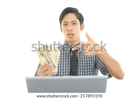 Smiling businessman with money on his hand - stock photo