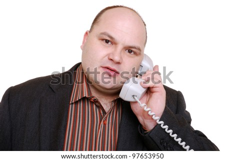 smiling businessman with telephone - stock photo
