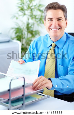 Smiling  businessman working in the office