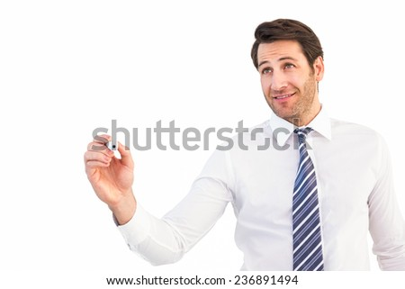 Smiling businessman writing with black marker on white background