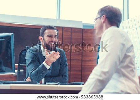 Smiling businessmen at meeting in office