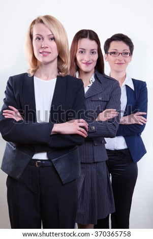 Smiling businesspeople standing together against a white background