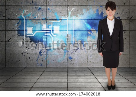 Smiling businesswoman against splash on wall revealing technology interface