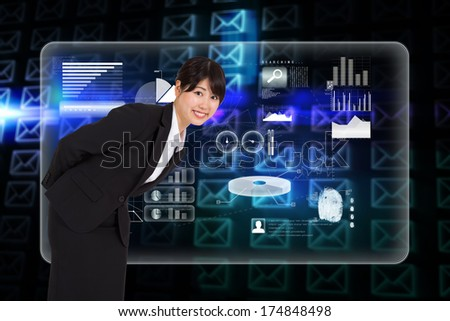 Smiling businesswoman bending against glowing envelopes on black background