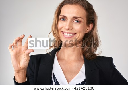 smiling businesswoman holding a blank card, copyspace for business details - stock photo